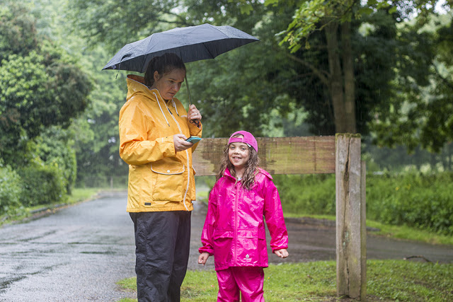 What is Geocaching - Zoe and Bubs in the rain looking for a cache