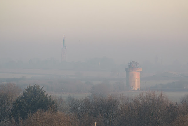 Water Tower and Church at Castlethorpe through the mist