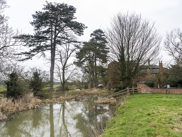 Mill buildings viewed along Great Ouse